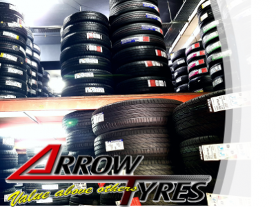 car accessories workshop carrying tyres of all sizes